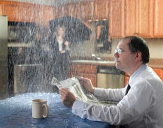 People in need of roof repair in Surry VA. Leaky roof causing it to rain on people in their kitchen. Humorous.